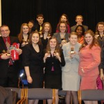 The Gustavus forensics team poses with its hardware from the recent Iowa Swing.