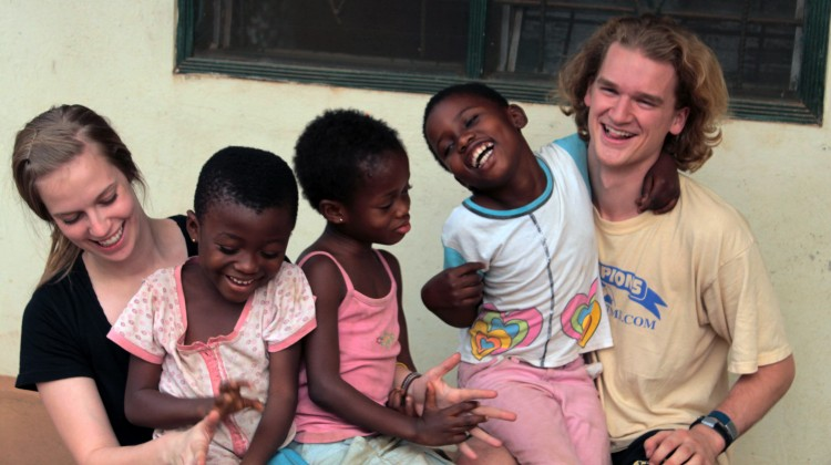 Yost and Matheson play with children in Kumasi, Ghana.