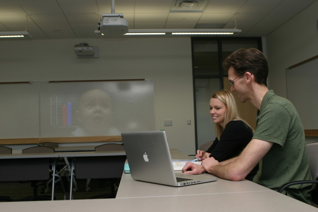 Assistant Professor of Psychological Science Kyle Chambers and sophomore student Haley Vollan (Photo by Tim Kennedy)