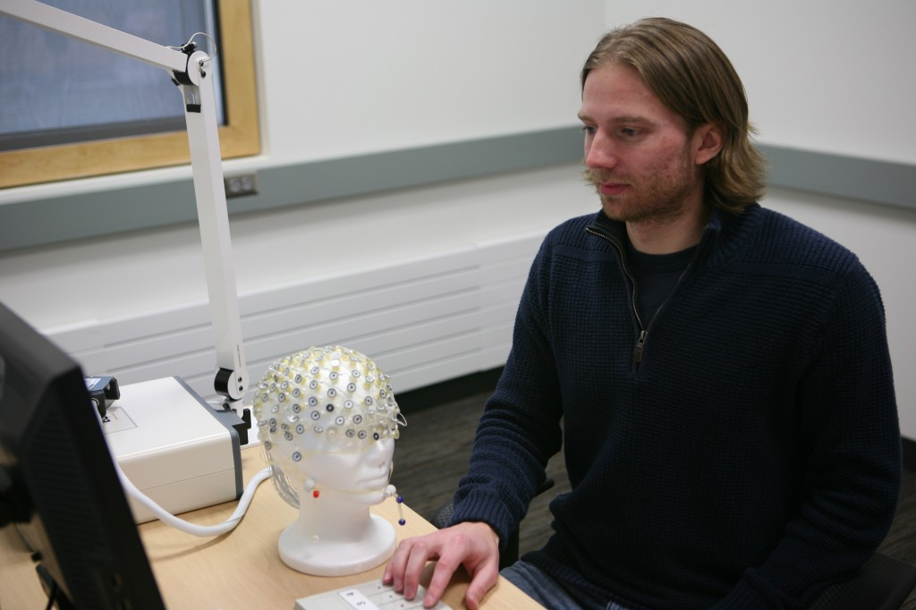 Wachutka works with EEG equipment in the Psychological Science Department's Social Neuroscience Lab (Photo by Matt Thomas '00).