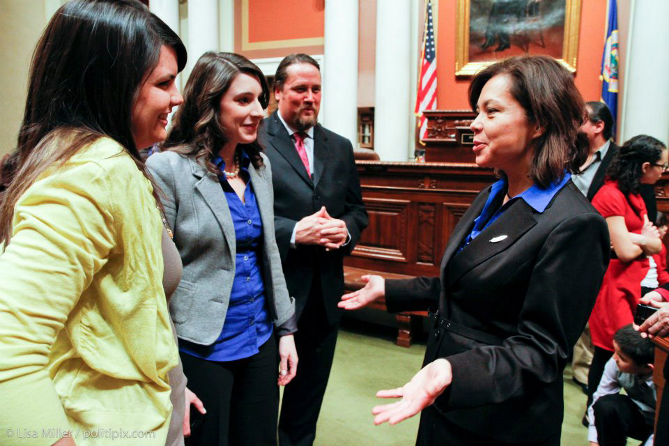 Meagan Bachmayer '08 (second from left) on the floor of the Minnesota House.