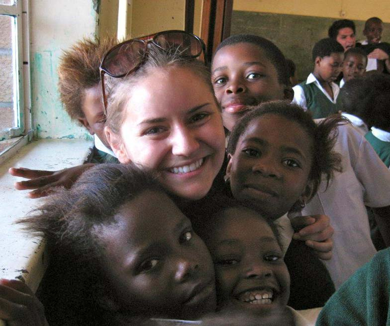 Sophomore Sophie Wertz makes new friends during the Symphony Orchestra's recent tour to South Africa.