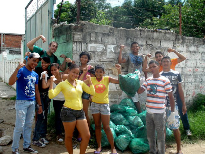 Matuseski (upper left) works with youth in Columbia on a community service project.