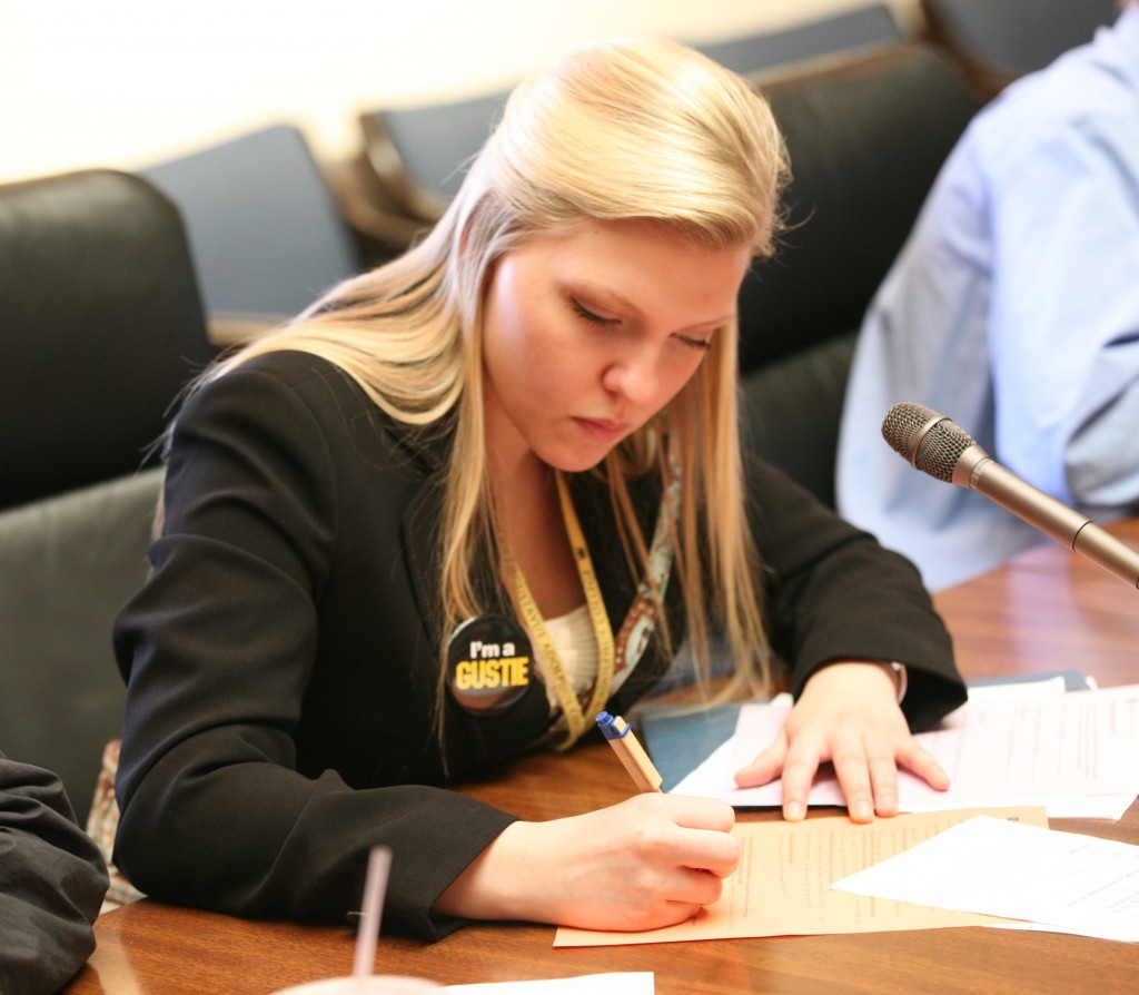 Pengelly takes notes at Gustavus' Day at the Capital event.