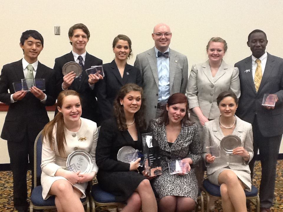 Members of the Gustavus forensics team with their hardware from this year's AFA-NIET.