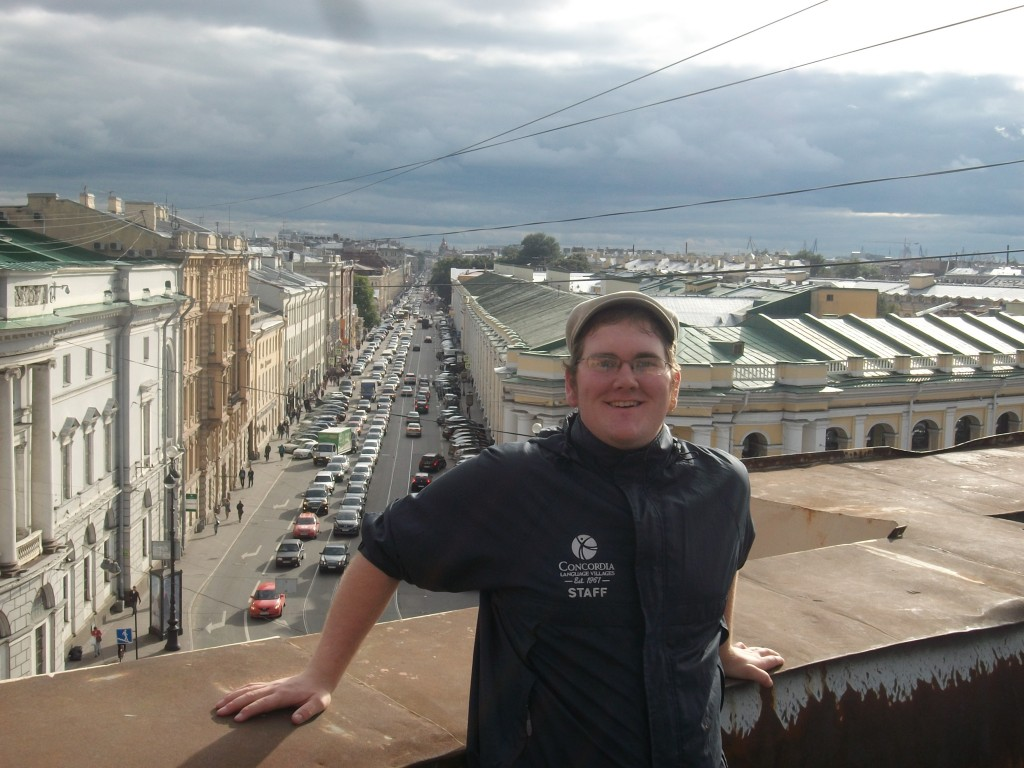 Joey Taylor '13 on a roof in St. Petersburg overlooking Nevskii Prospekt.