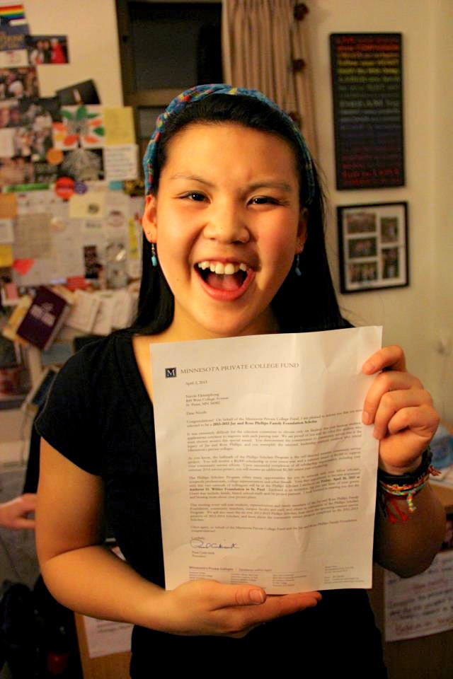 Ektnitphong with the letter informing her that she was the recipient of a Phillips Scholarship.