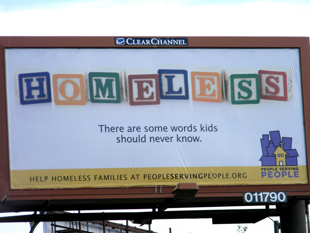 This billboard sits at the intersection of 3rd Street and Portland Avenue in Minneapolis, just outside the People Serving People shelter.