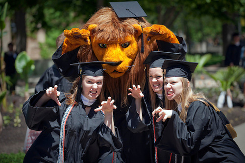 Several members of the class of 2013 pose with Gus the Lion (Photo by John Noltner).