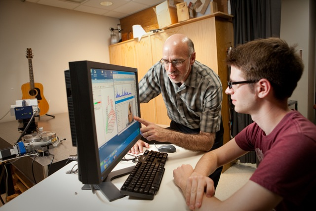 Professor Tom Huber and a student perform research in Huber's Acoustics Laboratory.