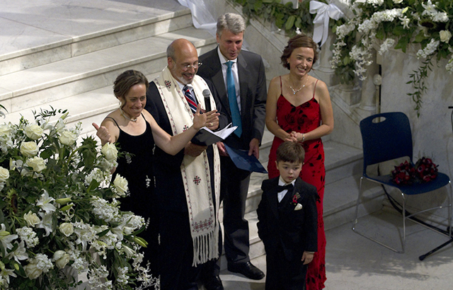 Cathy ten Broeke '91 (red dress) and Margaret Miles were the first same sex couple to be married at Minneapolis City Hall on Thursday, August 1. (Photo courtesy of MinnPost.com)