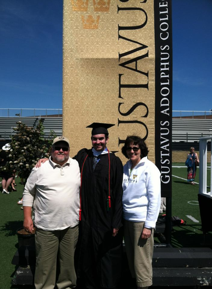 Michael Klajda '13 with his parents at commencement in June.