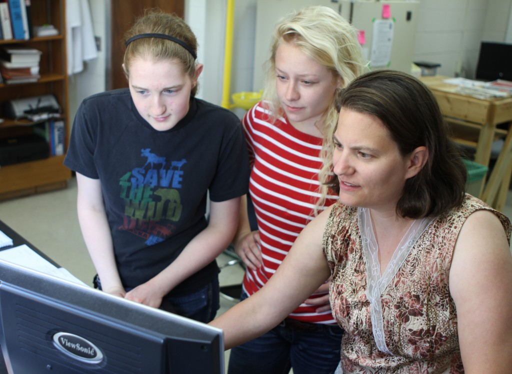 Junior Amy Christiansen '15, sophomore Alexa Peterson '16 and professor Amanda Nienow analyze data in one of the College's chemistry labs (Photo by Matt Thomas '00).