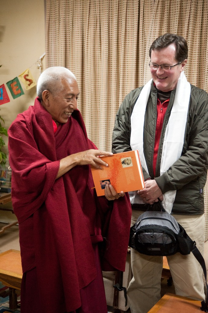 Professor Deane Curtin (right) receives a gift from former Prime Minister Professor Venerable Samdhong Rinpoche.