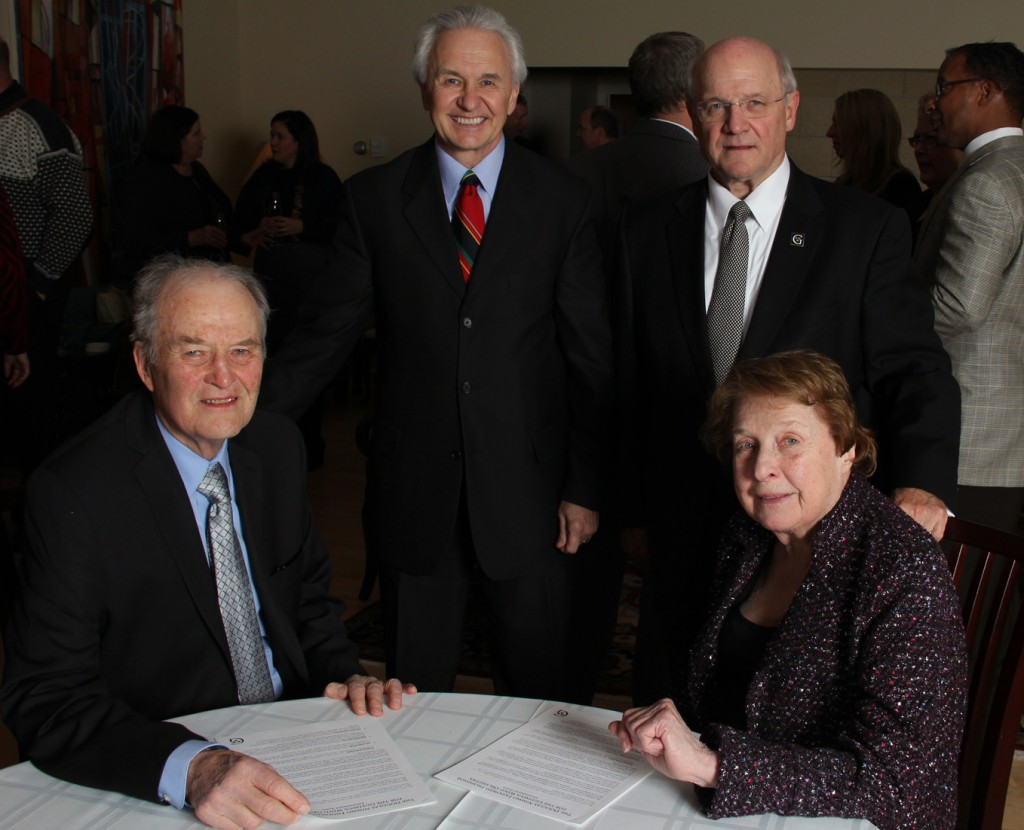 Ray '51 and Elaine Lundquist (seated) with Dr. Douglas Nimmo and President Jack Ohle.