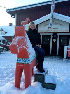 Ellen Krueger '14 posing on a Dala Horse.