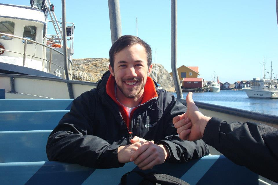 Will Metcalf '15 aboard a ferry boat, heading out to Hallo Island.