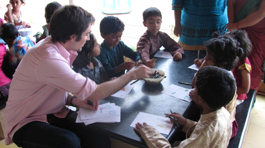 Moertel works with young children during his study abroad experience.