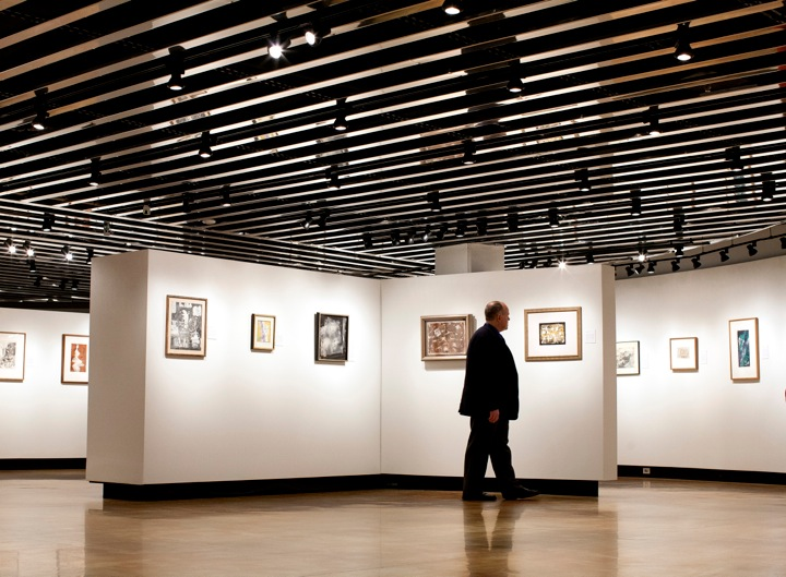 Don Myers walks through the Hillstrom Museum (Photo by Courtney Perry).