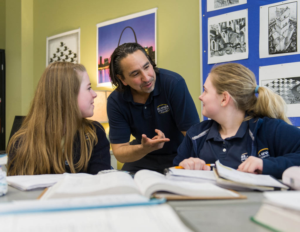 Jon Gutierrez '82 works with two students at St. Croix Preparatory Academy in Stillwater (Photo by Stan Waldhauser '71).