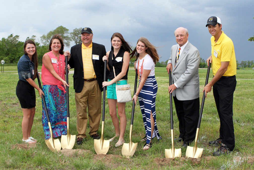 The Drenttel family, Mallory '17, Sandra, Ed '81, Taylor '12 and Jordan '15 take part in the ceremonial groundbreaking alongside President Jack R. Ohle and Head Coach Scott Moe.