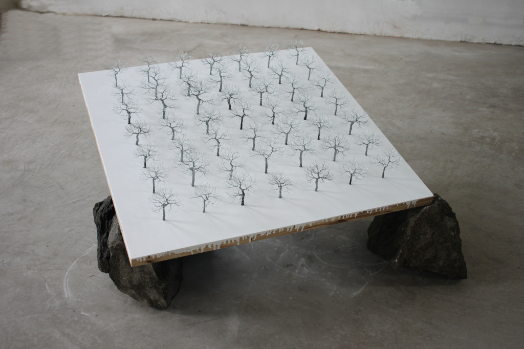 Yang Xinguang (born 1980), There Are Stones Below, 2011, iron, wire, plywood and stone, 47 1/4 x 47 1/4 x 21 5/8 inches