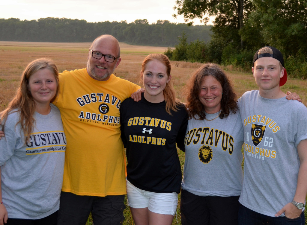 Gustavus senior Lindsay Rothschiller '15 (middle) with her host family in Sweden.