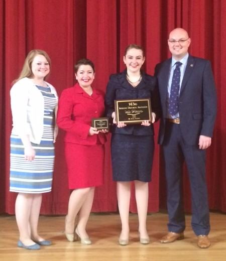 From left to right: Associate Director of Forensics Cadi Kadlecek, Emily Meyer, Karin Nordin, and Director of Forensics Kristofer Kracht.