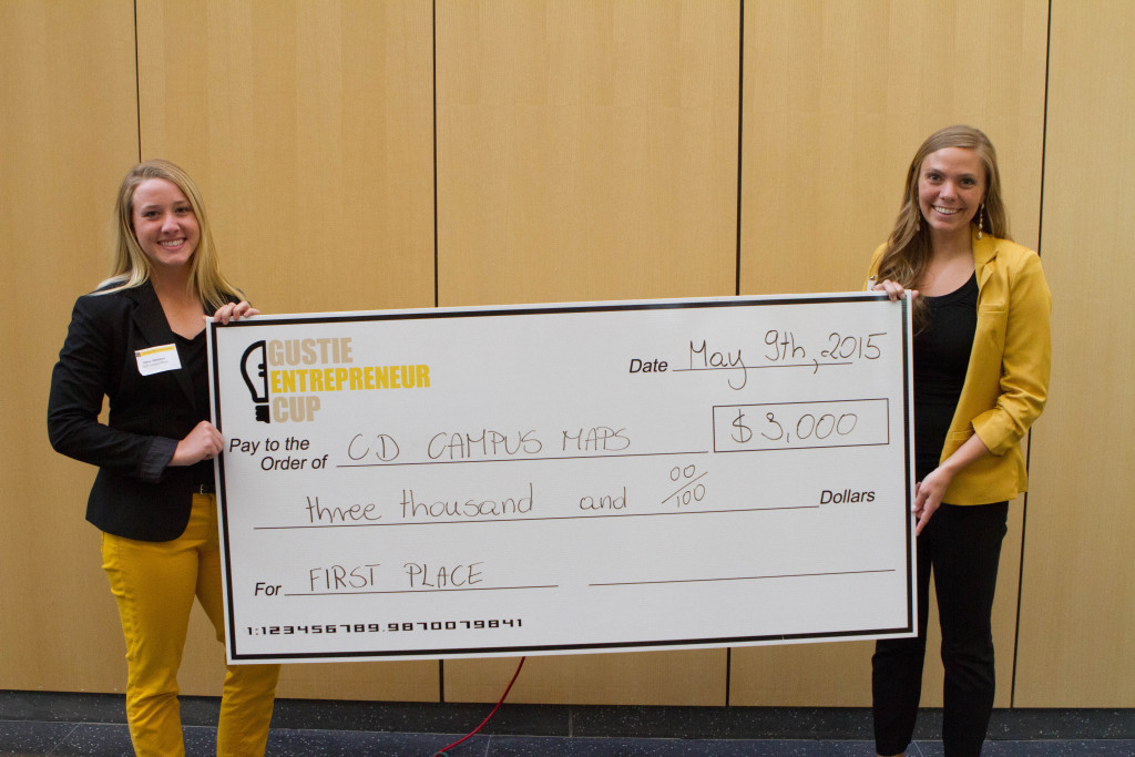 Chloe Altmann '15 and Danielle Kirchner '15 hoist the winning check from this year's Gustie Entrepreneur Cup.
