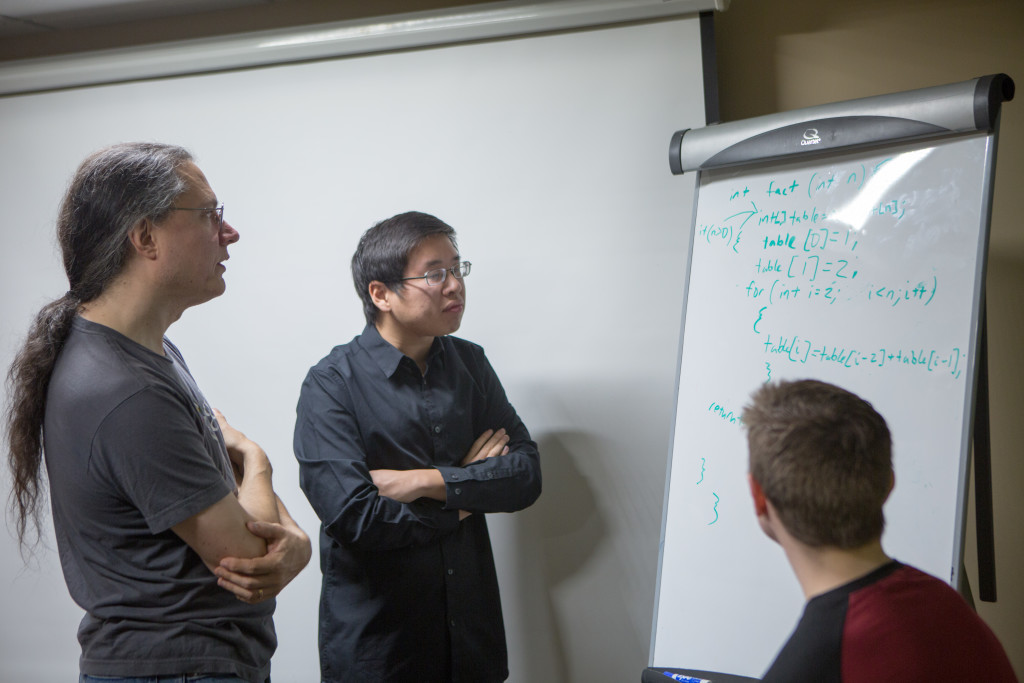 Eric Salo '88, left, met with computer science students on Dec. 19.