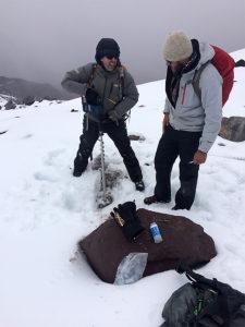 La Frenierre and Decker drill glacier ice to take a sample.