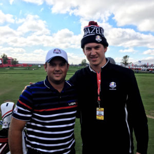 Kelley poses with PGA golfer and Ryder Cup champion Patrick Reed.