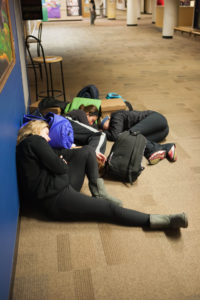 Students sleep in the Jackson Campus Center during the day.
