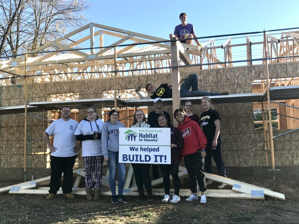 A group of Gusties at their Habitat for Humanity work site in Hibbing, Minnesota.