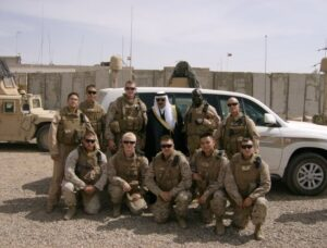 May (front row, center) with members of his unit in Iraq.