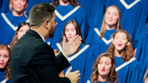 Conductor in front of the Gustavus Choir