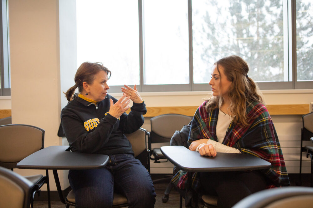Cynthia Favre talks to sophomore Emmie Peroutka during a Design Your Future class session.