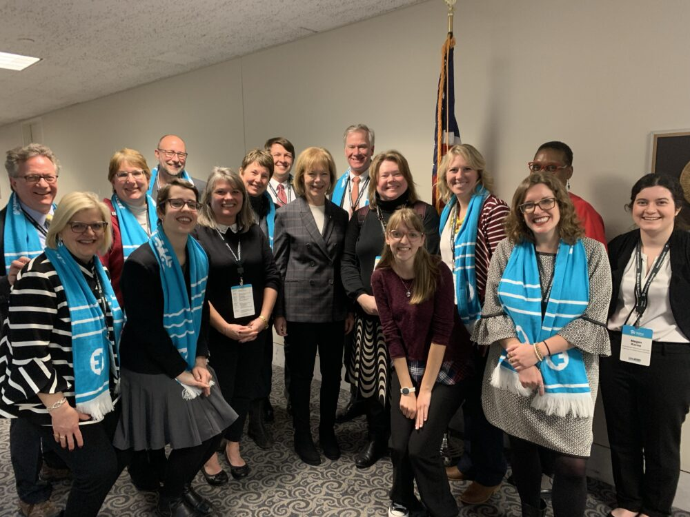 Marie Osuna (front row, third from right) and Amy Pehrson (back row, second from left) with Senator Tina Smith and fellow Habitat for Humanity Advocates.