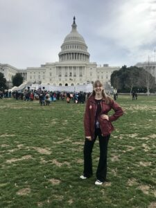 Marie Osuna in front of the U.S. Capitol.